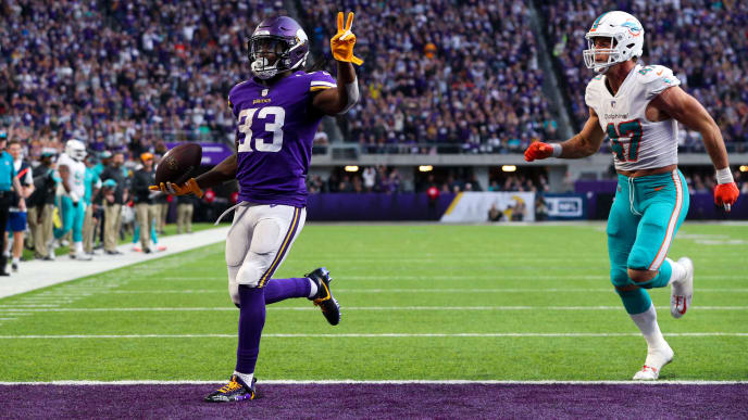 MINNEAPOLIS, MN - DECEMBER 16: Dalvin Cook #33 of the Minnesota Vikings runs with the ball for a 21 yard touchdown, his second of the day, in the fourth quarter of them game against the Miami Dolphins at U.S. Bank Stadium on December 16, 2018 in Minneapolis, Minnesota. (Photo by Adam Bettcher/Getty Images)