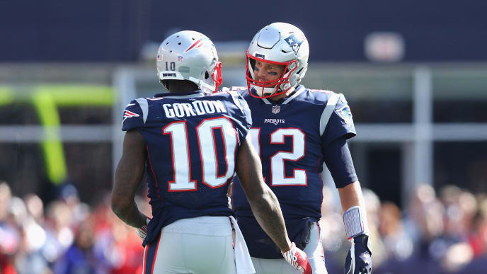 FOXBOROUGH, MA - SEPTEMBER 30:  Josh Gordon #10 talks with Tom Brady #12 of the New England Patriots during the second half against the Miami Dolphins at Gillette Stadium on September 30, 2018 in Foxborough, Massachusetts.  (Photo by Maddie Meyer/Getty Images)