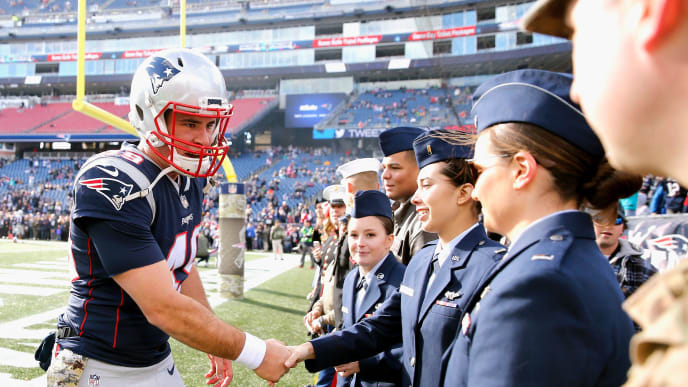 FOXBORO, MA - NOVEMBER 26: Joe Cardona #49 of the New England Patriots greets members of the military before a game against the Miami Dolphins at Gillette Stadium on November 26, 2017 in Foxboro, Massachusetts.  (Photo by Jim Rogash/Getty Images)