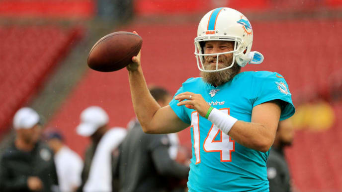 TAMPA, FLORIDA - AUGUST 16: Ryan Fitzpatrick #14 of the Miami Dolphins warms up against the Tampa Bay Buccaneers before their preseason game at Raymond James Stadium on August 16, 2019 in Tampa, Florida. (Photo by Mike Ehrmann/Getty Images)