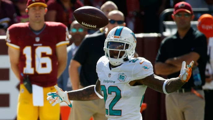 LANDOVER, MD - SEPTEMBER 13:  Jamar Taylor #22 of the Miami Dolphins breaks up a pass intended for Pierre Garcon #88 of the Washington Redskins at FedExField on September 13, 2015 in Landover, Maryland. (Photo by Rob Carr/Getty Images)