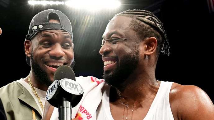 NEW YORK, NEW YORK - APRIL 10: Lebron James of the Los Angeles Lakers jokes with Dwyane Wade #3 of the Miami Heat after the game against the Brooklyn Nets at Barclays Center on April 10, 2019 in the Brooklyn borough of New York City. This was Wade's last NBA game before retirement. NOTE TO USER: User expressly acknowledges and agrees that, by downloading and or using this photograph, User is consenting to the terms and conditions of the Getty Images License Agreement.(Photo by Sarah Stier/Getty Images)