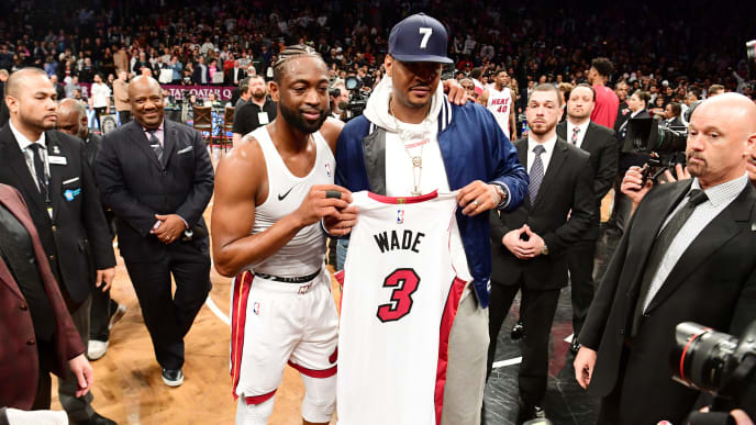 NEW YORK, NEW YORK - APRIL 10: Dwyane Wade #3 of the Miami Heat gives his jersey to former NBA player Carmelo Anthony after the game against the Brooklyn Nets at Barclays Center on April 10, 2019 in the Brooklyn borough of New York City. This was Wade's last NBA game before retirement. NOTE TO USER: User expressly acknowledges and agrees that, by downloading and or using this photograph, User is consenting to the terms and conditions of the Getty Images License Agreement.(Photo by Sarah Stier/Getty Images)