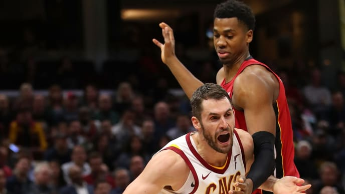CLEVELAND, OH - NOVEMBER 28:  Kevin Love #0 of the Cleveland Cavaliers tries to drive around Hassan Whiteside #21 of the Miami Heat during the second half at Quicken Loans Arena on November 28, 2017 in Cleveland, Ohio. Cleveland won the game 108-97. NOTE TO USER: User expressly acknowledges and agrees that, by downloading and or using this photograph, User is consenting to the terms and conditions of the Getty Images License Agreement.  (Photo by Gregory Shamus/Getty Images)