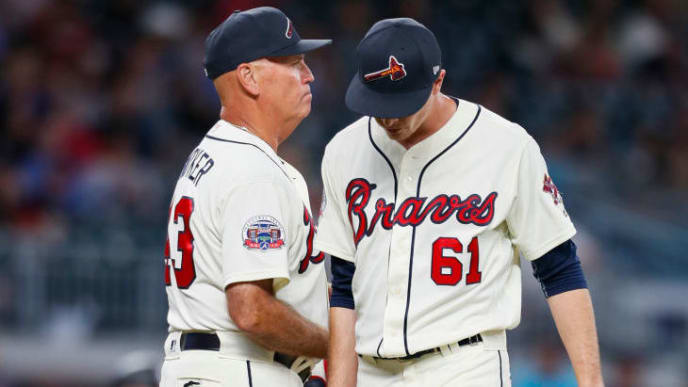 ATLANTA, GA - SEPTEMBER 9: Brian Snitker #43 of the Atlanta Braves pulls starting pitcher Max Fried #61 in the fourth inning of an MLB game against the Miami Marlins at SunTrust Park on September 9, 2017 in Atlanta, Georgia. (Photo by Todd Kirkland/Getty Images)