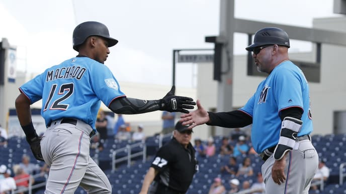 WEST PALM BEACH, FL - MARCH 14: Third base coach Fredi Gonzalez #33 congratulates Dixon Machado #12 of the Miami Marlins after he hit a home run against the Houston Astros during a spring training game at The Fitteam Ballpark of the Palm Beaches on March 14, 2019 in West Palm Beach, Florida. (Photo by Joel Auerbach/Getty Images)
