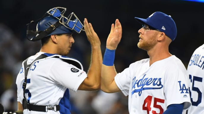 LOS ANGELES, CA - JULY 20: Matt Beaty #45 of the Los Angeles Dodgers is congratulated by Austin Barnes #15 of the Los Angeles Dodgers after the final out of the ninth inning of the game against the Miami Marlins at Dodger Stadium on July 20, 2019 in Los Angeles, California. (Photo by Jayne Kamin-Oncea/Getty Images)