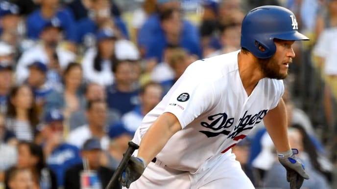 LOS ANGELES, CA - JULY 20: Clayton Kershaw #22 hits a RBI single to score Austin Barnes #15 of the Los Angeles Dodgers in the fourth inning of the game against the Miami Marlins at Dodger Stadium on July 20, 2019 in Los Angeles, California. (Photo by Jayne Kamin-Oncea/Getty Images)