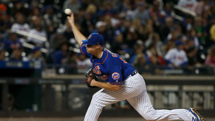 NEW YORK, NY - SEPTEMBER 28:  Corey Oswalt #55 of the New York Mets pitches during the second inning against the Miami Marlins at Citi Field on September 28, 2018 in the Flushing neighborhood of the Queens borough of New York City.  (Photo by Jim McIsaac/Getty Images)