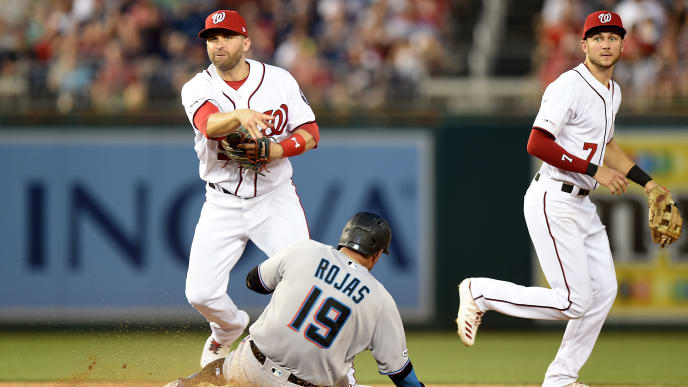 WASHINGTON, DC - JULY 03:  Brian Dozier #9 of the Washington Nationals forces out Miguel Rojas #19 of the Miami Marlins to start a double play in the eighth inning at Nationals Park on July 3, 2019 in Washington, DC.  (Photo by Greg Fiume/Getty Images)
