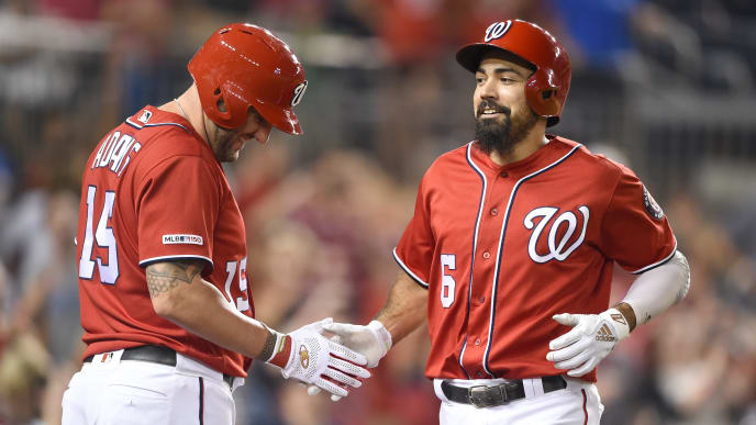 WASHINGTON, DC - AUGUST 31:  Anthony Rendon #6 of the Washington Nationals celebrates a solo home in the eight inning with Matt Adams #18 during a baseball game against the Miami Marlins at Nationals Park on August 31, 2019 in Washington, DC.  (Photo by Mitchell Layton/Getty Images)