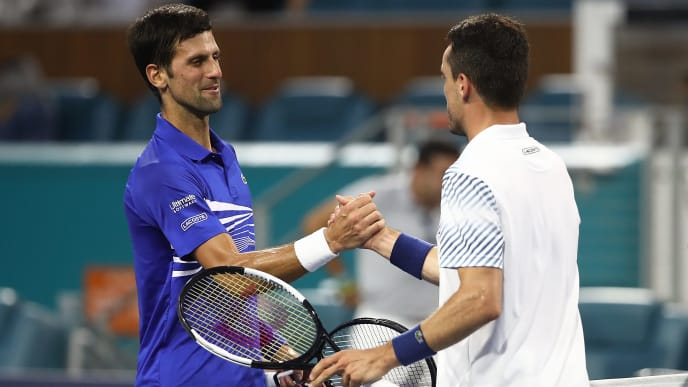 MIAMI GARDENS, FLORIDA - MARCH 26:  Roberto Bautista Agut of Spain is congratulated by Novak Djokovic of Serbia after their match during the Miami Open tennis on March 26, 2019 in Miami Gardens, Florida. (Photo by Julian Finney/Getty Images)
