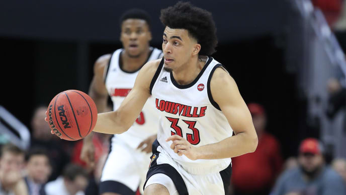 Louisville's Jordan Mwora dribbles up court against Miami.