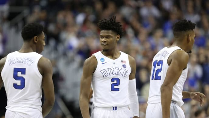 WASHINGTON, DC - MARCH 31: RJ Barrett #5, Cam Reddish #2 and Javin DeLaurier #12 of the Duke Blue Devils celebrate a basket against the Michigan State Spartans during the second half in the East Regional game of the 2019 NCAA Men's Basketball Tournament at Capital One Arena on March 31, 2019 in Washington, DC. (Photo by Rob Carr/Getty Images)