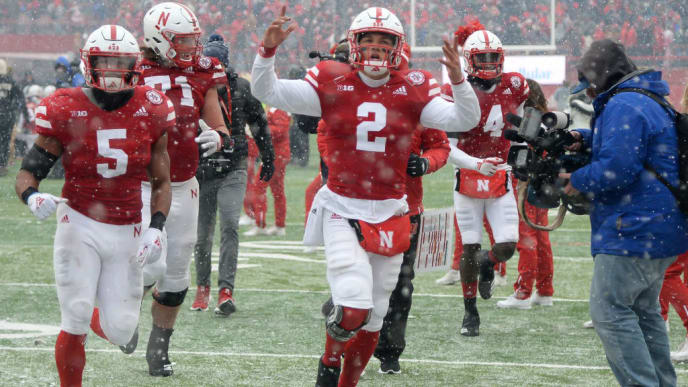 LINCOLN, NE - NOVEMBER 17: Quarterback Adrian Martinez #2 of the Nebraska Cornhuskers celebrates the win against the Michigan State Spartans at Memorial Stadium on November 17, 2018 in Lincoln, Nebraska. (Photo by Steven Branscombe/Getty Images)