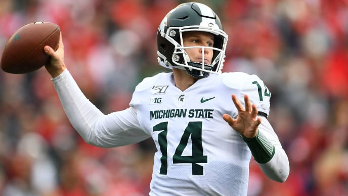 MADISON, WISCONSIN - OCTOBER 12:  Brian Lewerke #14 of the Michigan State Spartans looks to pass during the first half against the Wisconsin Badgers at Camp Randall Stadium on October 12, 2019 in Madison, Wisconsin. (Photo by Stacy Revere/Getty Images)