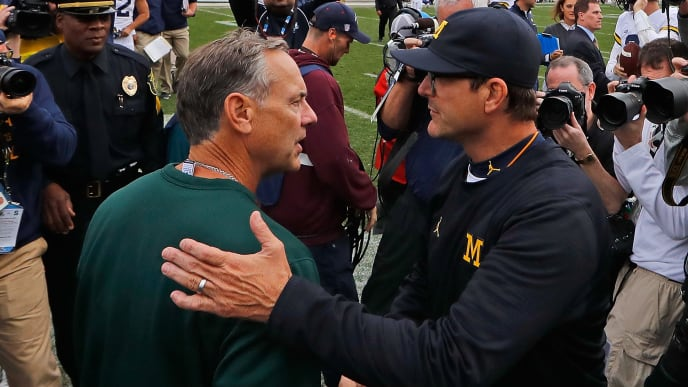 EAST LANSING, MI - OCTOBER 29: Michigan State Spartans coach Mark Dantonio and Michigan Wolverines head coach Jim Harbaugh shake hands at the end of the game at Spartan Stadium on October 29, 2016 in East Lansing, Michigan. Michigan defeated Michigan State 32-23. (Photo by Leon Halip/Getty Images)