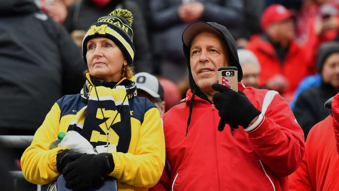COLUMBUS, OH - NOVEMBER 24:  Michigan and Ohio State fans watch the teams warm up before their game at Ohio Stadium on November 24, 2018 in Columbus, Ohio.  (Photo by Jamie Sabau/Getty Images)