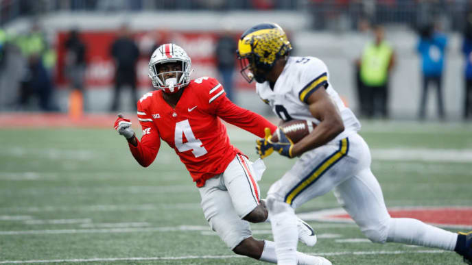 COLUMBUS, OH - NOVEMBER 24: Jordan Fuller #4 of the Ohio State Buckeyes looks to make a tackle against the Michigan Wolverines during the game at Ohio Stadium on November 24, 2018 in Columbus, Ohio. Ohio State won 62-39. (Photo by Joe Robbins/Getty Images)