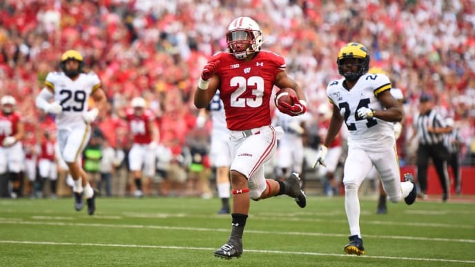 MADISON, WISCONSIN - SEPTEMBER 21:  Jonathan Taylor #23 of the Wisconsin Badgers rushes for a touchdown during the first half against the Michigan Wolverines at Camp Randall Stadium on September 21, 2019 in Madison, Wisconsin. (Photo by Stacy Revere/Getty Images)