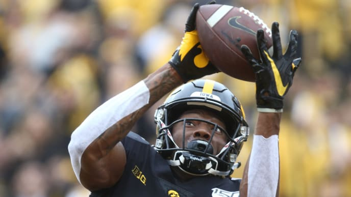IOWA CITY, IOWA- SEPTEMBER 28: Wide receiver Brandon Smith #12 of the Iowa Hawkeyes makes a touchdown catch during the first half against the Middle Tennessee Blue Raiders on September 28, 2019 at Kinnick Stadium in Iowa City, Iowa.  (Photo by Matthew Holst/Getty Images)