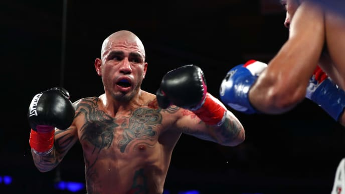 NEW YORK, NEW YORK - DECEMBER 02:  Miguel Cotto looks to punch Sadaam Ali during their Junior Middleweight bout at Madison Square Garden on December 02, 2017 in New York City. (Photo by Al Bello/Getty Images)