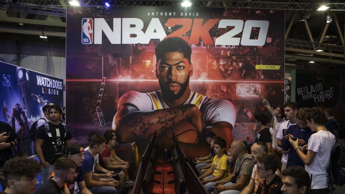 MILAN, ITALY - SEPTEMBER 27: Fairgoers play NBA 2K20 at the PS4 PlayStation stand during the Milan Games Week 2019, on September 27, 2019 in Milan, Italy. The Milan Games Week is the most important Italian consumer show dedicated to the gaming world. (Photo by Emanuele Cremaschi/Getty Images)