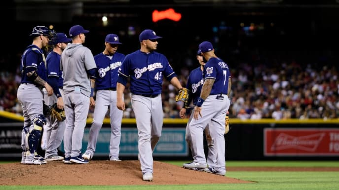 PHOENIX, ARIZONA - JULY 19: Jhoulys Chacin #45 of the Milwaukee Brewers is relieved by manager Craig Counsell #30 in the third inning of the MLB game against the Arizona Diamondbacks at Chase Field on July 19, 2019 in Phoenix, Arizona. (Photo by Jennifer Stewart/Getty Images)