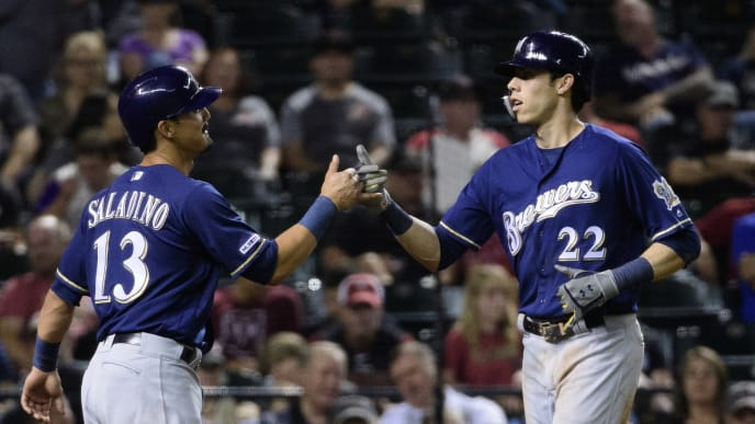 PHOENIX, ARIZONA - JULY 19: Christian Yelich #22 of the Milwaukee Brewers celebrates a two run home run with Tyler Saladino #13 in the seventh inning of the MLB game against the Arizona Diamondbacks at Chase Field on July 19, 2019 in Phoenix, Arizona. (Photo by Jennifer Stewart/Getty Images)