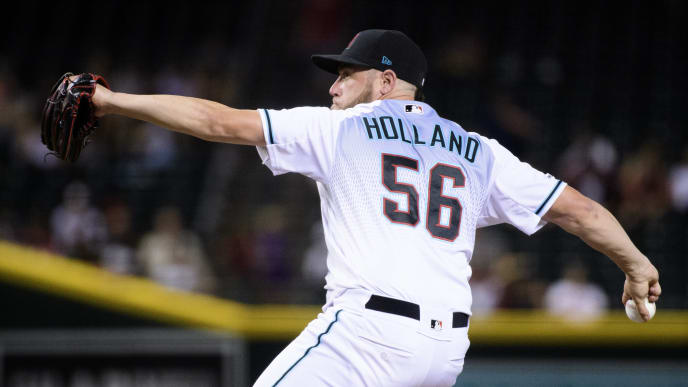 PHOENIX, ARIZONA - JULY 19: Greg Holland #56 of the Arizona Diamondbacks delivers a pitch in the ninth inning of the MLB game against the Milwaukee Brewers at Chase Field on July 19, 2019 in Phoenix, Arizona. The Arizona Diamondbacks won 10-7.  (Photo by Jennifer Stewart/Getty Images)