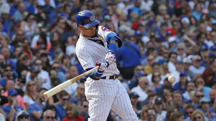 CHICAGO, ILLINOIS - AUGUST 30: Javier Baez #9 of the Chicago Cubs hits a double in the 6th inning against the Milwaukee Brewers at Wrigley Field on August 30, 2019 in Chicago, Illinois. (Photo by Jonathan Daniel/Getty Images)
