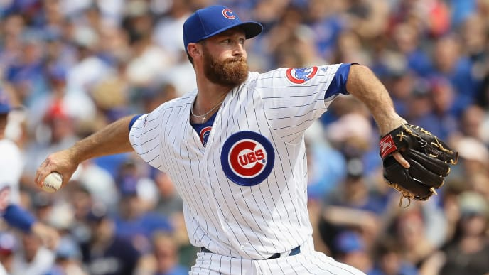 CHICAGO, IL - AUGUST 18: Spencer Patton #45 of the Chicago Cubs pitches in the 7th inning against the Milwaukee Brewers at Wrigley Field on August 18, 2016 in Chicago, Illinois. (Photo by Jonathan Daniel/Getty Images)