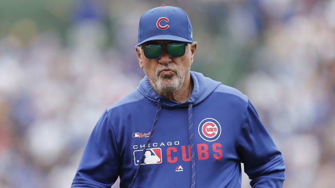 CHICAGO, ILLINOIS - SEPTEMBER 01: Manager Joe Maddon #70 of the Chicago Cubs returns to the dugout after checking on Javier Baez #9 during the third inning of a game against the Milwaukee Brewers at Wrigley Field on September 01, 2019 in Chicago, Illinois. (Photo by Nuccio DiNuzzo/Getty Images)