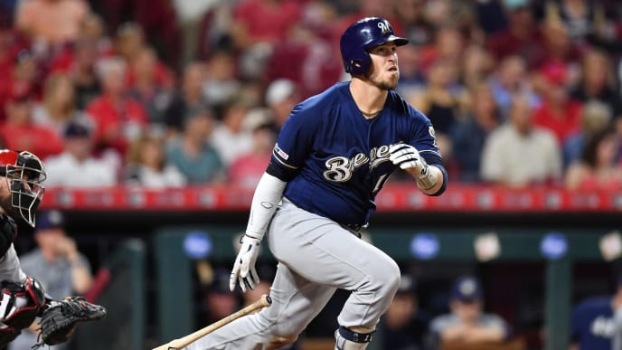 CINCINNATI, OH - SEPTEMBER 24:  Yasmani Grandal #10 of the Milwaukee Brewers bats against the Cincinnati Reds at Great American Ball Park on September 24, 2019 in Cincinnati, Ohio.  (Photo by Jamie Sabau/Getty Images)