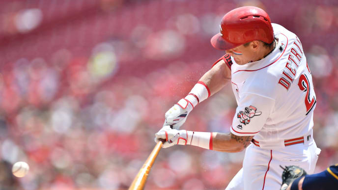 CINCINNATI, OH - JULY 4:  Derek Dietrich #22 of the Cincinnati Reds hits a single to load the bases in the first inning against the Milwaukee Brewers at Great American Ball Park on July 4, 2019 in Cincinnati, Ohio.  (Photo by Jamie Sabau/Getty Images)