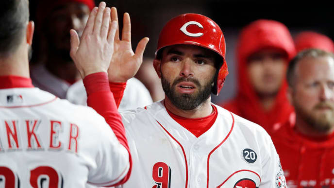 CINCINNATI, OH - APRIL 01: Jose Peraza #9 of the Cincinnati Reds celebrates in the dugout after scoring a run to tie the game against the Milwaukee Brewers in the sixth inning at Great American Ball Park on April 1, 2019 in Cincinnati, Ohio. The Brewers won 4-3. (Photo by Joe Robbins/Getty Images)