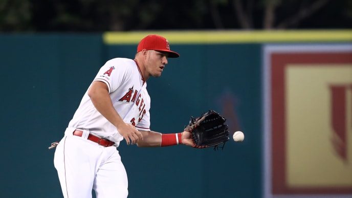 ANAHEIM, CALIFORNIA - APRIL 08: Mike Trout #27 of the Los Angeles Angels fields a single hit by Christian Yelich #22 of the Milwaukee Brewers during the first inning of a game at Angel Stadium of Anaheim on April 08, 2019 in Anaheim, California. (Photo by Sean M. Haffey/Getty Images)