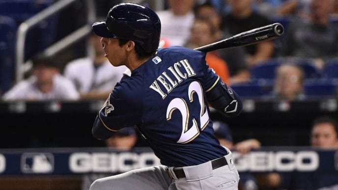 MIAMI, FLORIDA - SEPTEMBER 10: Christian Yelich #22 of the Milwaukee Brewers follows through on a swing in the first inning against the Miami Marlins at Marlins Park on September 10, 2019 in Miami, Florida. (Photo by Mark Brown/Getty Images)