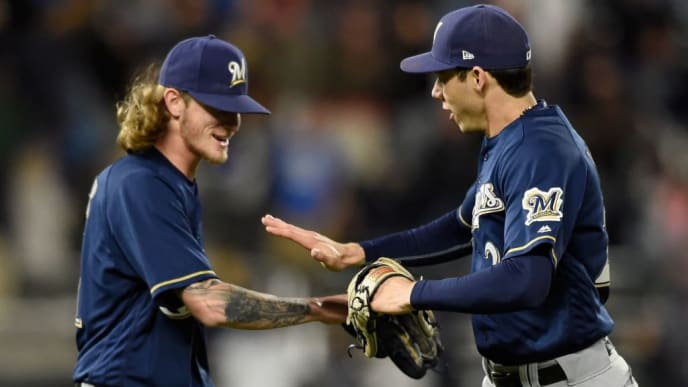 MINNEAPOLIS, MN - MAY 19: Josh Hader #71 and Christian Yelich #22 of the Milwaukee Brewers celebrate defeating the against the Minnesota Twins 5-4 after the interleague game on May 19, 2018 at Target Field in Minneapolis, Minnesota. (Photo by Hannah Foslien/Getty Images)