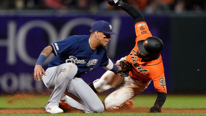 SAN FRANCISCO, CALIFORNIA - JUNE 14: Kevin Pillar #1 of the San Francisco Giants slides safely into second, dislodging the base, before the tag by Orlando Arcia #3 of the Milwaukee Brewers during the seventh inning at Oracle Park on June 14, 2019 in San Francisco, California. (Photo by Daniel Shirey/Getty Images)