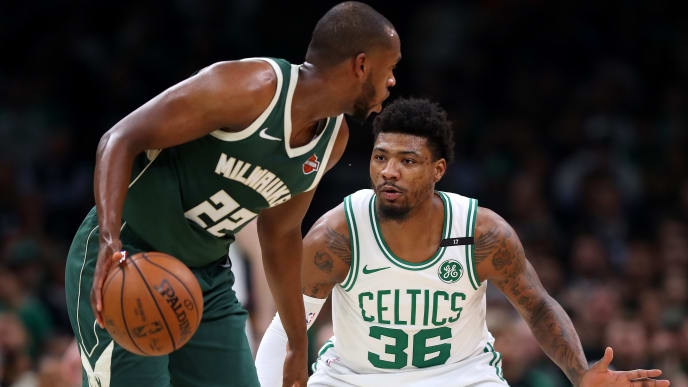 BOSTON, MASSACHUSETTS - MAY 06: Marcus Smart #36 of the Boston Celtics defends Khris Middleton #22 of the Milwaukee Bucks during the first quarter of Game 4 of the Eastern Conference Semifinals during the 2019 NBA Playoffs at TD Garden on May 06, 2019 in Boston, Massachusetts. (Photo by Maddie Meyer/Getty Images)