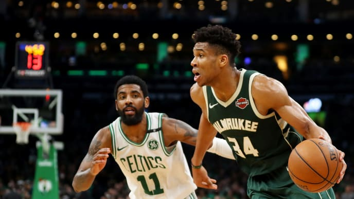 BOSTON, MASSACHUSETTS - MAY 03: Giannis Antetokounmpo #34 of the Milwaukee Bucks drives against Kyrie Irving #11 of the Boston Celtics during the second half of Game 3 of the Eastern Conference Semifinals of the 2019 NBA Playoffs at TD Garden on May 03, 2019 in Boston, Massachusetts. The Bucks defeat the Celtics 123 - 116.  (Photo by Maddie Meyer/Getty Images)