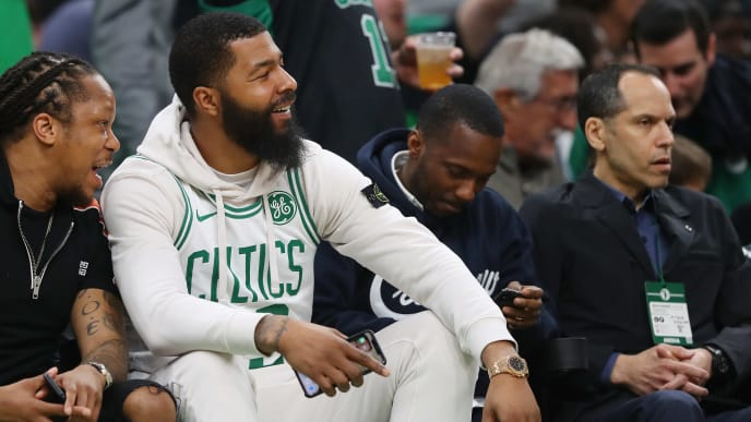 BOSTON, MASSACHUSETTS - MAY 03: Markieff Morris, second from left, watches his twin brother Marcus Morris #13 of the Boston Celtics during the second half of Game 3 of the Eastern Conference Semifinals of the 2019 NBA Playoffs between the Boston Celtics and the Milwaukee Bucks at TD Garden on May 03, 2019 in Boston, Massachusetts. The Bucks defeat the Celtics 123 - 116.  (Photo by Maddie Meyer/Getty Images)