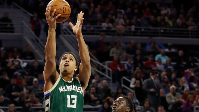 AUBURN HILLS, MI - DECEMBER 28: Malcolm Brogdon #13 of the Milwaukee Bucks gets a first half shot off next to Reggie Jackson #1 of the Detroit Pistons at the Palace of Auburn Hills on December 28, 2016 in Auburn Hills, Michigan. NOTE TO USER: User expressly acknowledges and agrees that, by downloading and or using this photograph, User is consenting to the terms and conditions of the Getty Images License Agreement.  (Photo by Gregory Shamus/Getty Images)