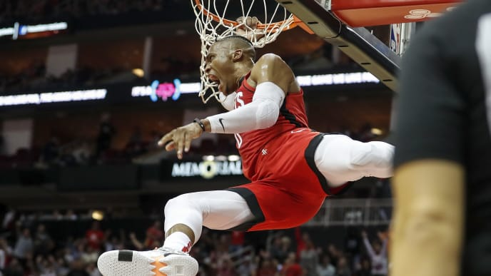 HOUSTON, TX - OCTOBER 24:  Russell Westbrook #0 of the Houston Rockets dunks the ball defended by Ersan Ilyasova #7 of the Milwaukee Bucks in the second half at Toyota Center on October 24, 2019 in Houston, Texas.  NOTE TO USER: User expressly acknowledges and agrees that, by downloading and or using this photograph, User is consenting to the terms and conditions of the Getty Images License Agreement.  (Photo by Tim Warner/Getty Images)