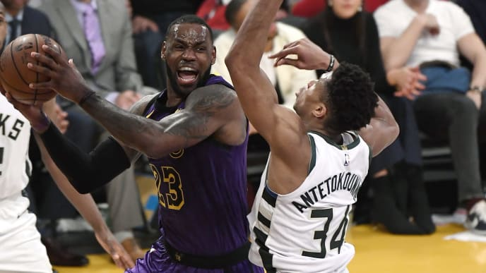 LOS ANGELES, CA - MARCH 01: LeBron James #23 of the Los Angeles Lakers passes the ball under pressure from Giannis Antetokounmpo #34 of the Milwaukee Bucks during the second half at Staples Center on March 1, 2019 in Los Angeles, California. NOTE TO USER: User expressly acknowledges and agrees that, by downloading and or using this photograph, User is consenting to the terms and conditions of the Getty Images License Agreement. (Photo by Kevork Djansezian/Getty Images)
