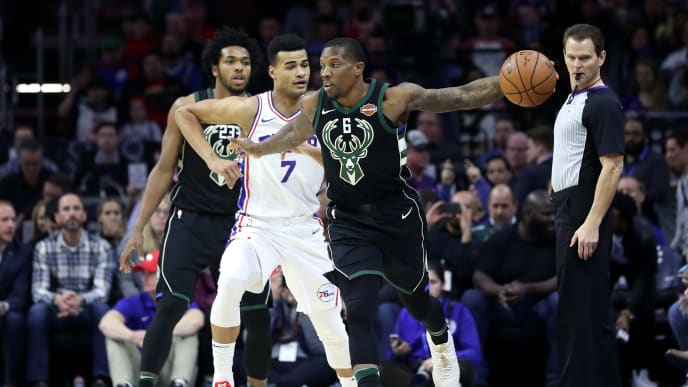 PHILADELPHIA, PA -JANUARY 20: Eric Bledsoe #6 of the Milwaukee Bucks controls the ball in front of Timothe Luwawu-Cabarrot #7 of the Philadelphia 76ers in the first half at Wells Fargo Center on January  20, 2018 in Philadelphia, Pennsylvania. NOTE TO USER: User expressly acknowledges and agrees that, by downloading and or using this photograph, User is consenting to the terms and conditions of the Getty Images License Agreement. (Photo by Rob Carr/Getty Images)