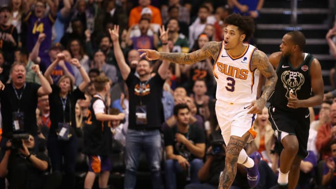PHOENIX, ARIZONA - MARCH 04:  Kelly Oubre Jr. #3 of the Phoenix Suns reacts after hitting a three-point shot over Khris Middleton #22 of the Milwaukee Bucks during the second half of the NBA game at Talking Stick Resort Arena on March 04, 2019 in Phoenix, Arizona. The Suns defeated the Bucks 114-105.  (Photo by Christian Petersen/Getty Images)