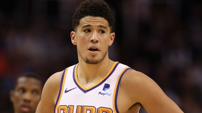 PHOENIX, ARIZONA - MARCH 04:  Devin Booker #1 of the Phoenix Suns during the second half of the NBA game against the Milwaukee Bucks at Talking Stick Resort Arena on March 04, 2019 in Phoenix, Arizona. The Suns defeated the Bucks 114-105.  (Photo by Christian Petersen/Getty Images)