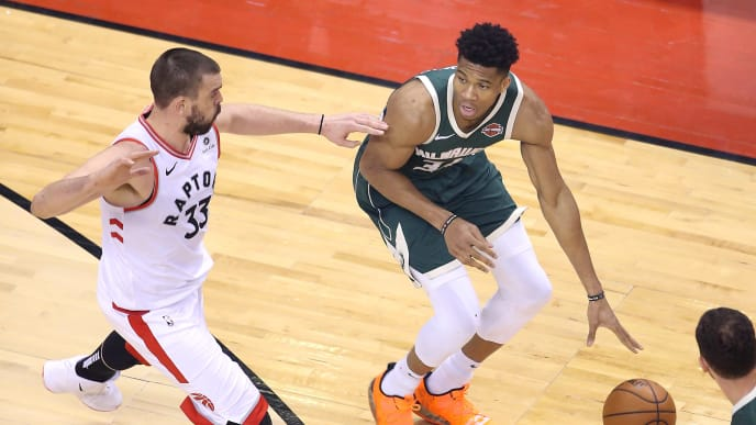 TORONTO, ONTARIO - MAY 21: Giannis Antetokounmpo #34 of the Milwaukee Bucks handles the ball during the second half against Marc Gasol #33 of the Toronto Raptors in game four of the NBA Eastern Conference Finals at Scotiabank Arena on May 21, 2019 in Toronto, Canada. NOTE TO USER: User expressly acknowledges and agrees that, by downloading and or using this photograph, User is consenting to the terms and conditions of the Getty Images License Agreement. (Photo by Claus Andersen/Getty Images)